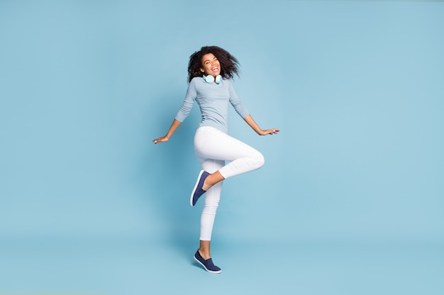 Full length body size side profile photo of cheerful positive cute nice girlfriend with eyes closed excited about having been left alone in white pants isolated pastel blue color background