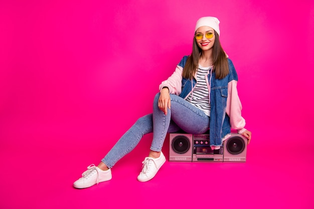 Full length body size view of her she nice attractive charming pretty lovely cheerful girl sitting on boom-box spending holiday isolated on bright vivid shine vibrant pink fuchsia color