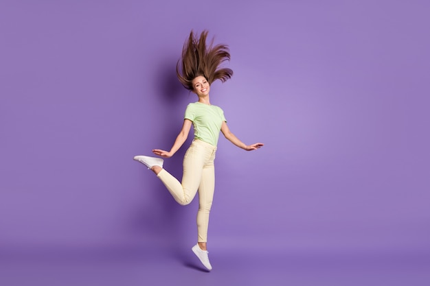 Full length body size view of her she nice attractive cheerful thin girl jumping having fun free time dancing spending weekend party isolated bright vivid shine vibrant lilac violet color background