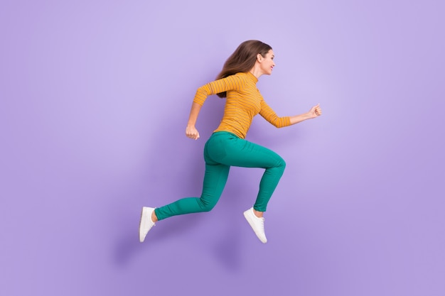 Full length body size view of her she nice attractive lovely charming cheerful cheery glad purposeful energetic girl running fast isolated over violet purple lilac pastel color