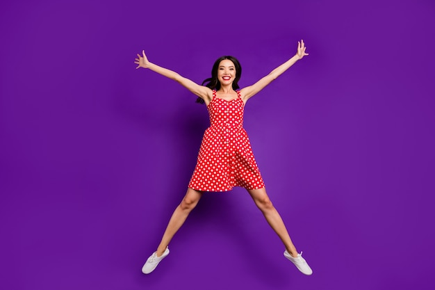 Full length body size view of her she nice attractive pretty lovely cheerful cheery free wavy-haired girl jumping having fun isolated on bright vivid shine vibrant lilac purple violet backgroun