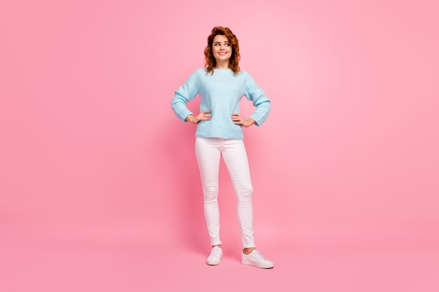 Full length body size view of her she nice-looking attractive lovely pretty lovable cute cheerful cheery wavy-haired girl posing looking aside isolated over pink pastel color background
