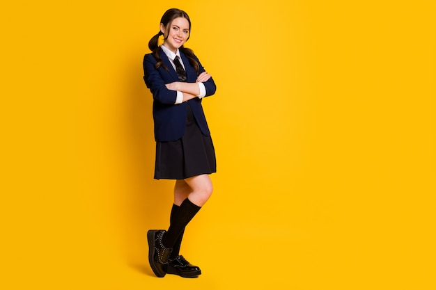 Full length body size view of lovely cheerful schoolgirl folded arms