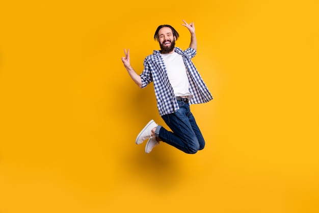 Full length body size view of nice attractive cheerful cheery bearded guy in checked shirt jumping