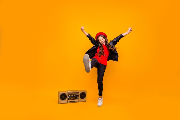 Full length body size view of nice attractive cheerful cheery crazy brunette long-haired girl wearing streetstyle having fun dancing isolated over bright vivid shine vibrant yellow color wall