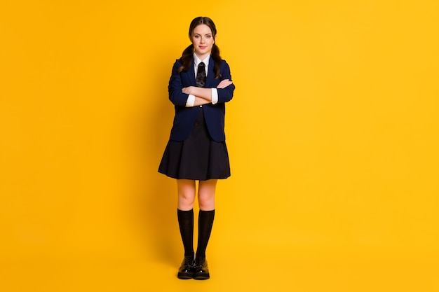 Full length body size view of pretty charming schoolgirl folded arms