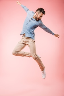 Full length of a cheerful young man jumping