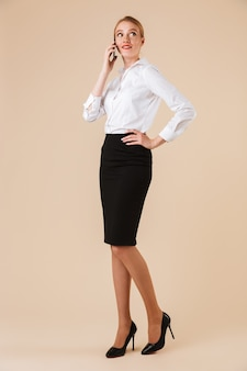 Full length confident businesswoman