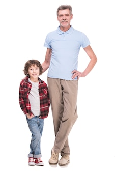Full length of grandfather and grandson are posing.