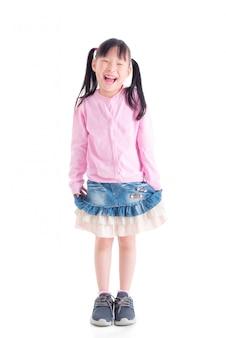 Full length of happy little asian girl smiling over white space
