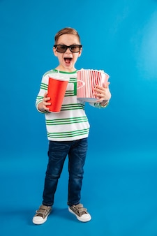 Full length image of happy young boy in eyeglasses