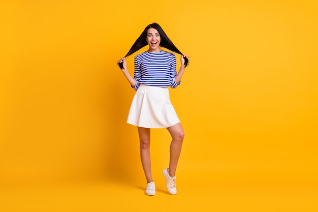 Full length photo of astonished positive girl touch her clean clear straight hair impressed smooth lotion effect wear good look outfit isolated over bright color background