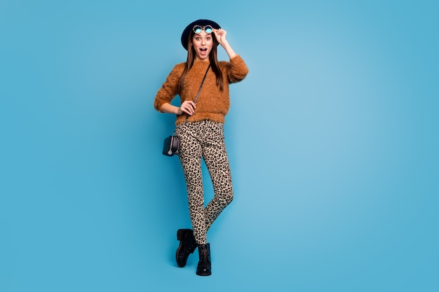Full length photo of crazy funky girl touch specks stare see black friday discounts scream shout wear stylish trendy fall spring clothes isolated over blue color wall