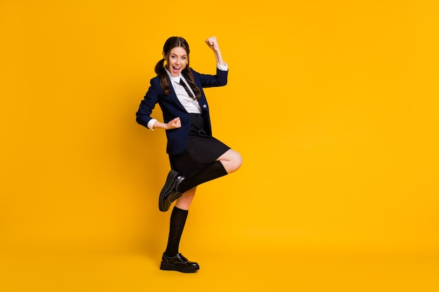 Full length photo of crazy high school teenage girl enjoy exam good grades win