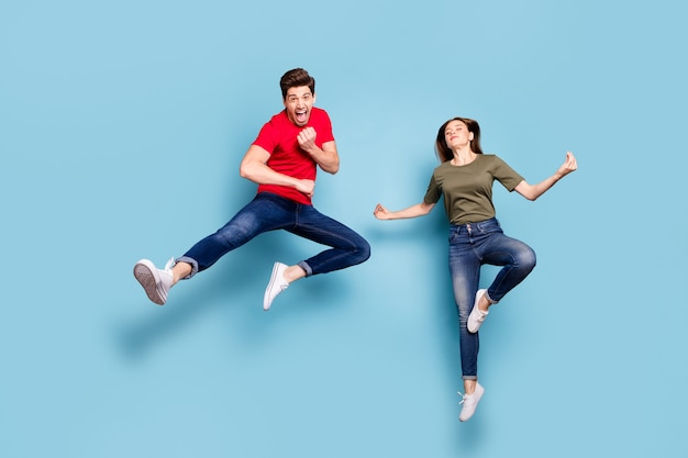 Full length photo of funky crazy two married people students man train fighting exercise karate woman jump practice chakra yoga meditate om wear  outfit isolated blue color background