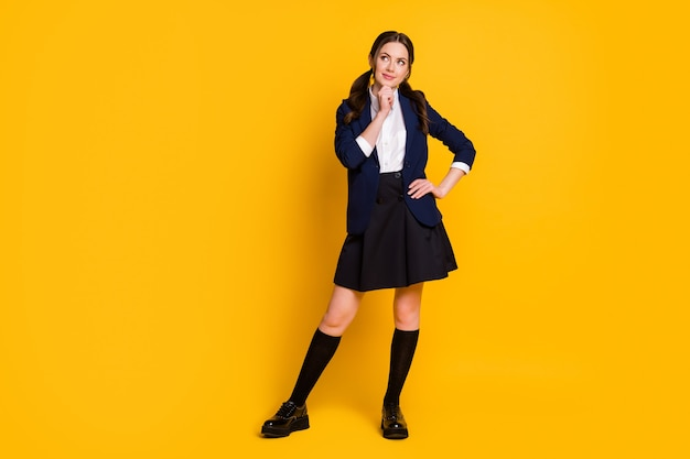 Full length photo of minded student girl touch hand chin look copyspace