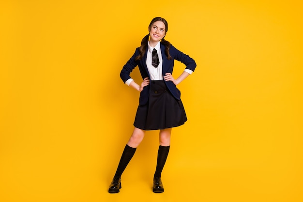Full length photo of positive curious smart high school girl look copyspace plan