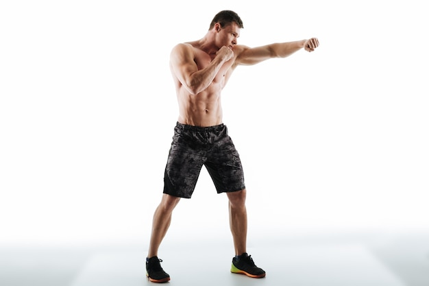 Full length photo of strong half naked man in boxing pose
