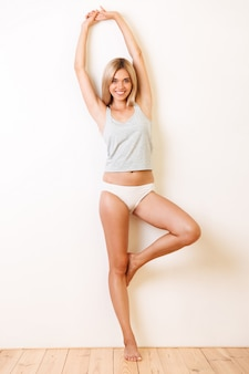 Full length portrait of an attractive young girl in underwear