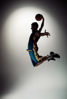 Full length portrait of a basketball player with ball