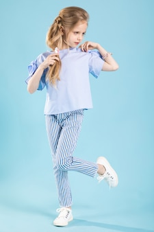 Full-length portrait of a beautiful girl in blue clothes
