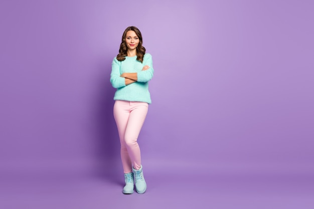 Full length portrait of beautiful pretty lady curly hairstyle good mood arms crossed self-confident person wear pastel fluffy sweater pink pants shoes.