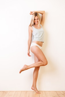 Full length portrait of a beautiful young girl in underwear
