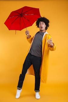 Full length portrait of a cheerful afro american man