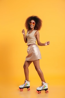 Full length portrait of a cheerful afro american woman