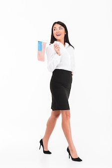 Full length portrait of a cheerful asian businesswoman