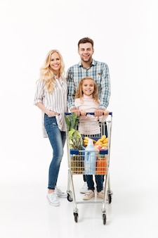 Full length portrait of a cheerful family