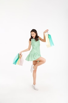 Full length portrait of a cheery girl in dress