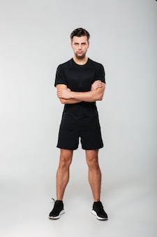 Full length portrait of a concentrated young sportsman