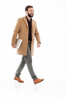 Full length portrait of a confident bearded guy