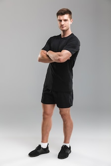 Full length portrait of a confident young sportsman