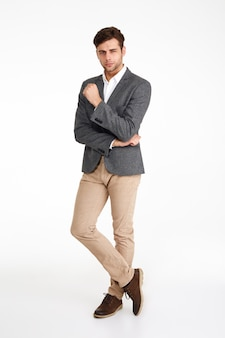 Full length portrait of a confindent attractive man in a jacket