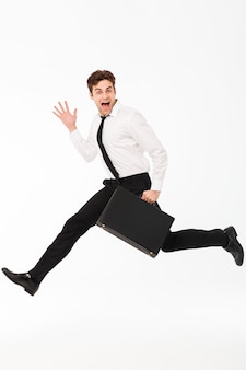 Full length portrait of an excited handsome businessman