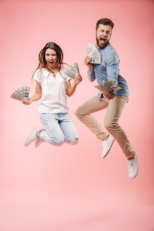 Full length portrait of an excited young couple