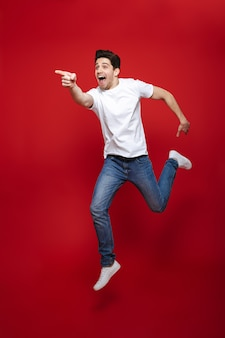 Full length portrait of an excited young man