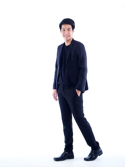 Full length portrait of handsome young man posing on white wall