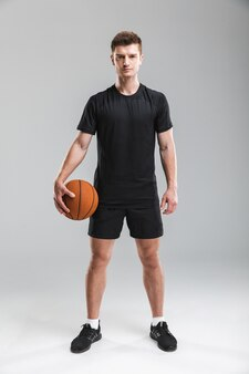 Full length portrait of a handsome young sportsman