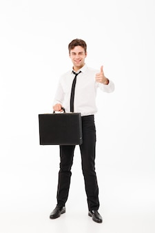 Full length portrait of a happy handsome businessman