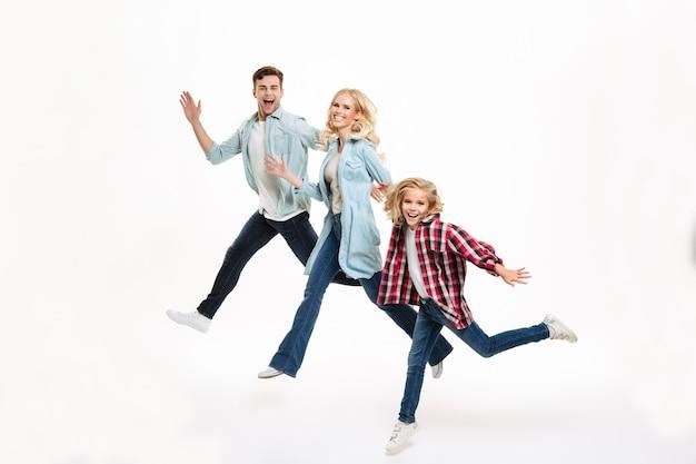 Full length portrait of a happy joyful family