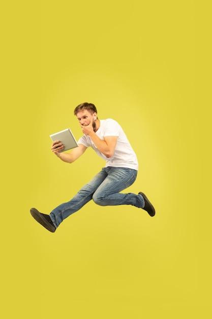 Full length portrait of happy jumping man