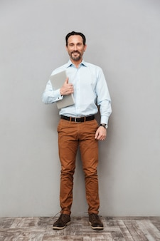 Full length portrait of a happy mature man