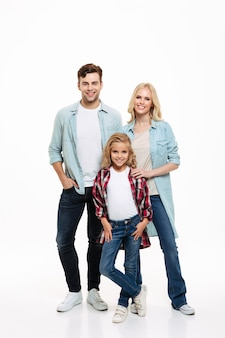Full length portrait of a happy smiling family with a child