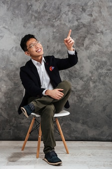 Full length portrait of a happy young asian man