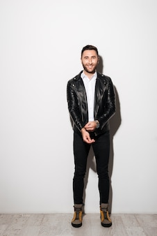 Full length portrait of a happy young man in jacket