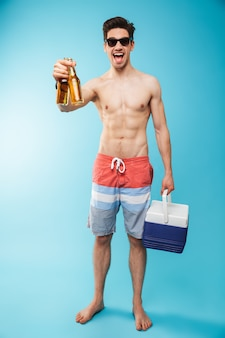 Full length portrait if an excited shirtless man