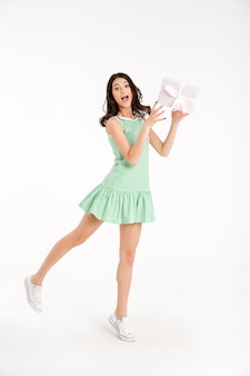 Full length portrait of a joyful girl dressed in dress
